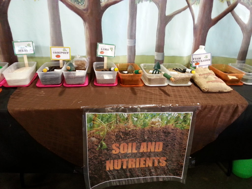 table with boxes of different soil ammendments